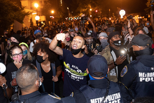 Black Lives Matter supporters shout at police near Black Lives Matter Plaza during the final night of the Republican National Convention (RNC) in Washington, DC, USA, 27 August 2020. Large protest are expected as the RNC culminates tonight with US President Donald J. Trump delivering a speech on the South Lawn of the White House with fireworks to follow. (Photo by Michael Reynolds/EPA/EFE)