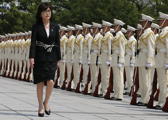 In this August 4, 2016 file photo, Japan's new Defense Minister Tomomi Inada inspects a honor guard on her first day at the Defense Ministry in Tokyo. Inada, who holds her first meeting with U.S. counterpart Ash Carter on Thursday, September 15, in Washington, D.C., leapfrogged over more senior lawmakers to the defense post in a Cabinet reshuffle on Aug. 3. The 57-year-old lawyer has attracted attention for questioning mainstream accounts of Japanese atrocities during World War II and the fairness of the postwar Tokyo war crimes trials. (Photo by Shuji Kajiyama/AP Photo)