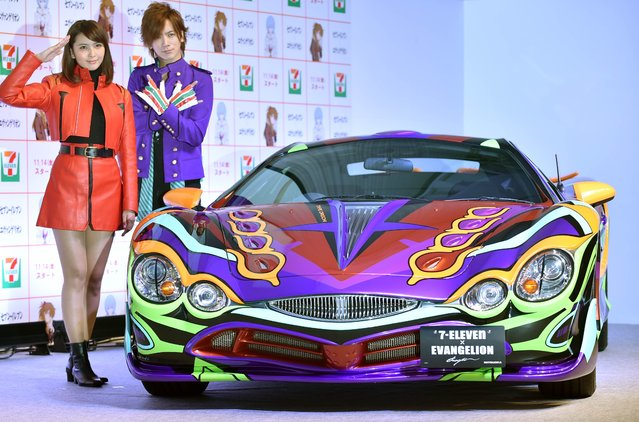 "Japanese singer-songwriter Daigo (2nd R) and actress Natsuki Kato (L) stand next to the special car named ""Seven-Eleven limited Mitsuoka Motors Evangelion Orochi"" during a photo session at a press conference in Tokyo on November 11, 2014. Japanese retail giant Seven & i Holdings Co. announced its collaboration campiagn with popular anime ""Evangelion"" that the special model limited to one will be launched in Seven-Eleven with a price of 16 million yen (139,000 USD), the highest ever price in commodity dealing. (Photo by Kazuhiro Nogi/AFP Photo)"