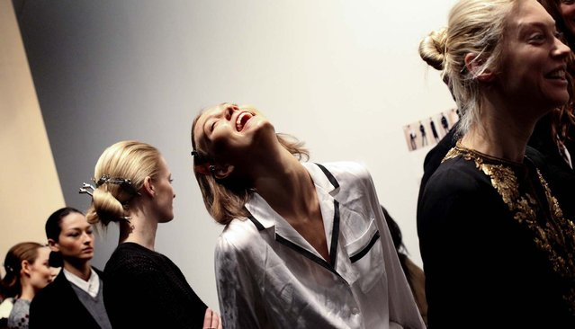 Karlie Kloss laughs during rehearsal backstage at the Ralph Lauren presentation at St. John Center Studios on the last day of Mercedes-Benz Fashion Week in New York on February 14, 2013. (Photo by Erin Baiano/The New York Times)