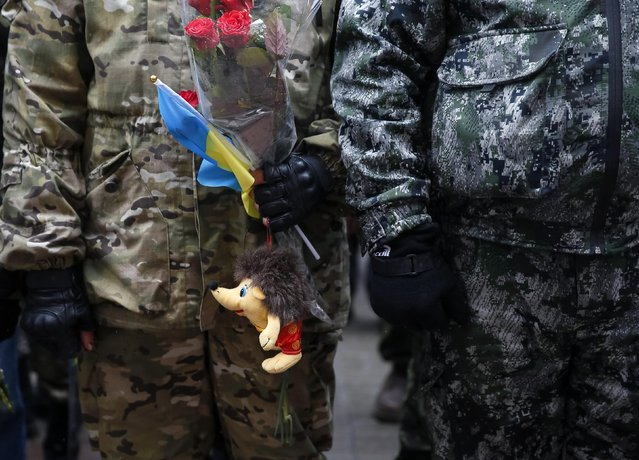 "Servicemen of ""Kiev 12"" military defence battalion take part in a welcoming ceremony in central Ukrainian capital Kiev December 6, 2014. (Photo by Gleb Garanich/Reuters)"