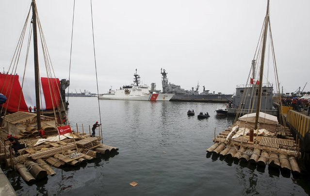 Wooden rafts of the Kon-Tiki II expedition are prepared at the port of Callao prior to the departure to Pascua island in Chile, in Callao, Peru, October 30, 2015. (Photo by Mariana Bazo/Reuters)