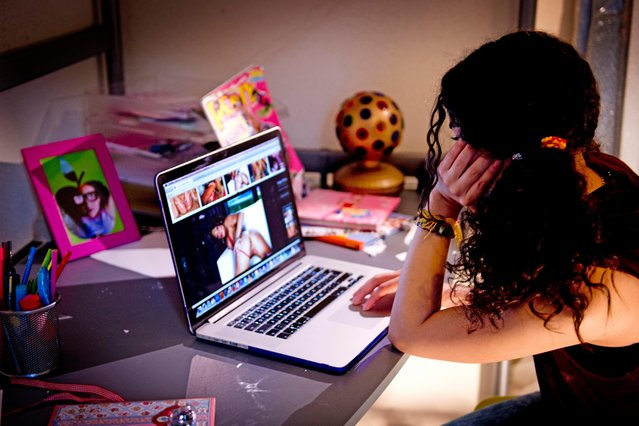 A teen teenager is secretly in her room watching p*rn on the internet on a laptop. (Photo by NurPhoto/Corbis via Getty Images)