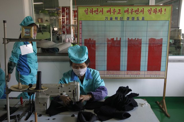 Workers wearing face masks at the Wonsan Leather Shoes Factory, where they manufacture handmade leather shoes in Wonsan, Kangwon Province, North Korea DPRK, on Wednesday, October 28, 2020. (Photo by Jon Chol Jin/AP Photo)