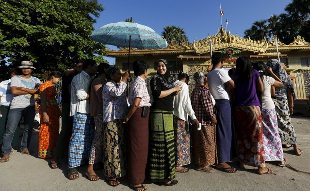 A muslim voter lines up to vote in a Buddhist prayer hall during the general election in Mandalay, Myanmar, November 8, 2015. (Photo by Olivia Harris/Reuters)