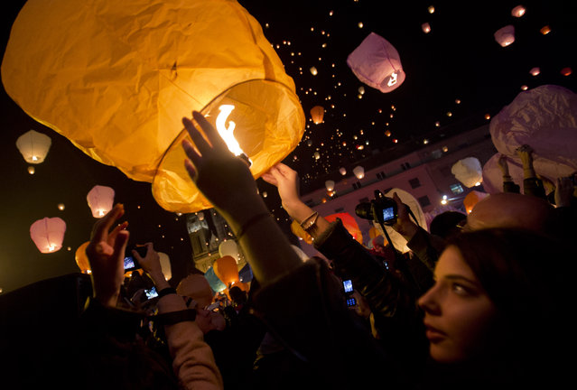 Paper lanterns are released as a part of Christmas festivities in Zagreb, Croatia, Monday, December 22, 2014. (Photo by Darko Bandic/AP Photo)