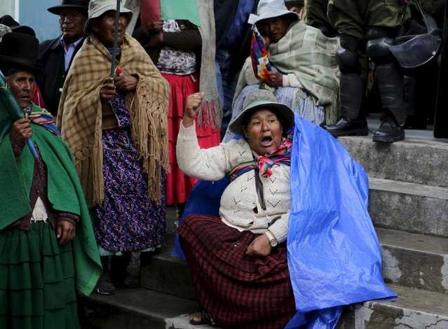 Women participate in a protest in La Paz, November 24, 2015. Thousands of residents of Pacajes, a province in the department of La Paz, arrived in La Paz to demand government investments in their region, according to local media. (Photo by David Mercado/Reuters)