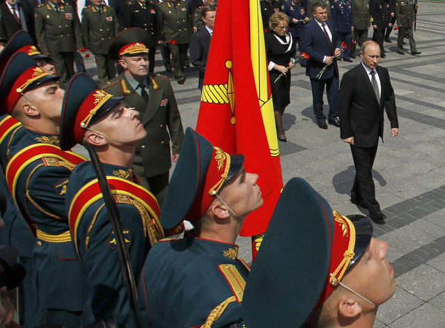 Vladimir Putin takes part in a wreath laying ceremony to commemorate the beginning of the Great Patriotic War against Nazi Germany in 1941 at the Tomb of the Unknown Soldier by the Kremlin wall in Moscow June 22, 2012. (Photo by Maxim Shemetov/Reuters)