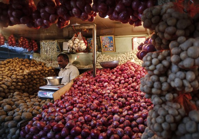 A vendor waits for customers at his vegetable stall at a wholesale fruit and vegetable market in Mumbai January 14, 2015. India's wholesale price inflation inched up to 0.11 percent in December, snapping a six-month easing trend as food costs jumped up year-on-year, government data showed on Wednesday. (Photo by Shailesh Andrade/Reuters)