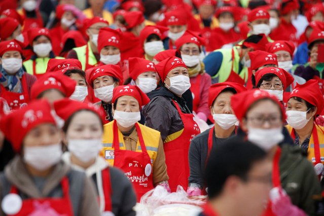People take part in the Seoul Kimchi Festival in central Seoul, South Korea, November 4, 2016. (Photo by Kim Hong-Ji/Reuters)