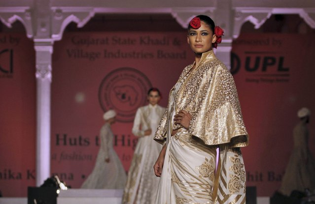 """In this Saturday, January 17, 2015 photo, a model displays a creation by designer Rohit Bal during a fashion show to promote """"Khadi"""", or hand-spun fabric in Ahmadabad, India. (Photo by Ajit Solanki/AP Photo)"""