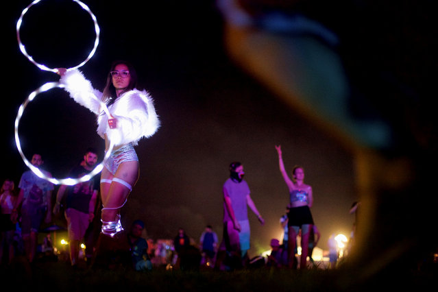 Lili Mitchell, 23, dances to Lil Xan on the second day of the Firefly Music Festival in Dover, Delaware U.S., June 16, 2018. (Photo by Mark Makela/Reuters)