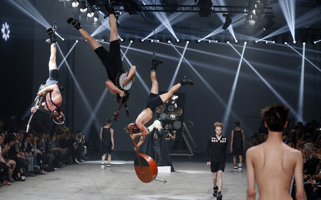 """For his spring 2014 show, designer Rick Owens asked """"scary, sleazy, and over the top"""" Estonian hardcore punk band and Eurovision 2013 contestants, Winny Puuh, to share the runway – or, at least, the space above the runway. (Photo by Patrick Kovarik)"""