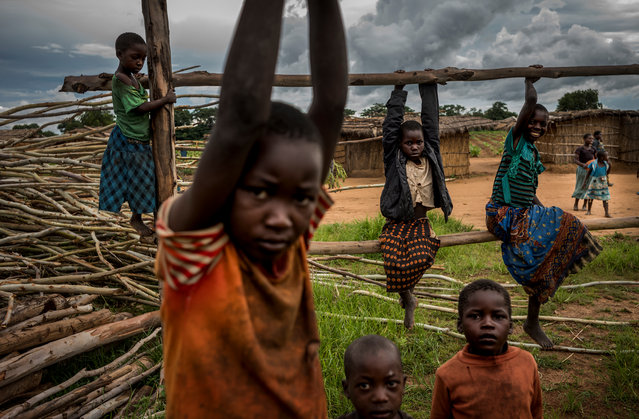 Children play in the village. (Photo by David Levene/The Guardian)