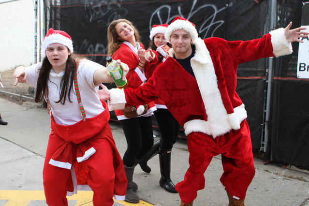 SantaCon 2015 on December 12, 2015. This year it started in Greenpoint Brooklyn at  McCarren park and later in the day will make it's way into the East Village in Manhattan. (Photo by Bruce Cotler/Globe Photos via ZUMA Wire)
