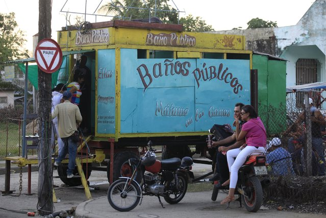 Cubans use a mobile ecological bathroom in Vertientes, Camaguey province November 13, 2015. Mario Munoz, 46, self-employed, is the owner of the mobile eco-bathroom. (Photo by Enrique de la Osa/Reuters)