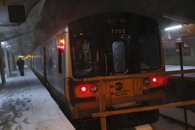 A Long Island Railroad train is seen parked at the Port Washington station in Port Washington, New York January 26, 2015. A massive, wind-whipped blizzard slammed into the U.S. Northeast on Monday, creating havoc for more than 60 million people and forcing New York City to shut down on a scale not seen since Superstorm Sandy devastated the region in 2012. (Photo by Shannon Stapleton/Reuters)
