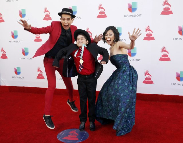 Recording artist Andres Salguero aka 123 Andres (L) arrives with guests at the 17th Annual Latin Grammy Awards in Las Vegas, Nevada, U.S., November 17, 2016. (Photo by Steve Marcus/Reuters)