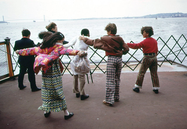 Students play in the wind during a school excursion on the Staten Island Ferry, crossing upper New York Bay, in June of 1973. (Photo by Arthur Tress/NARA via The Atlantic)