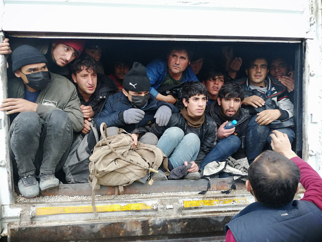 114 foreign national people, who have entered the country illegally, are seen in a truck, involved in a traffic accident where a person died, in Ercis district of Van, Turkey on March 03, 2021. (Photo by Necmettin Karaca/Anadolu Agency via Getty Images)