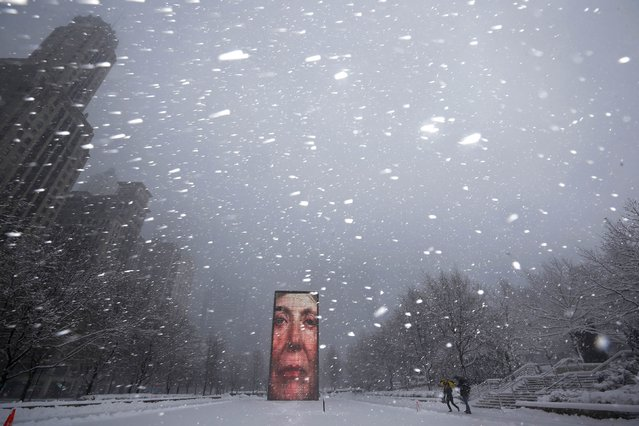 Two men walk past the Crown Fountain in blizzard conditions in Chicago, Illinois February 1, 2015. (Photo by Jim Young/Reuters)