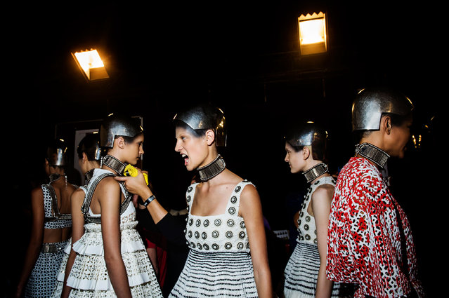 """Models wait backstage at the Alexander McQueen fashion show. Paris Fashion Week, Spring 2014. From the series """"Fashion Lust"""". (Photo by Dina Litovsky)"""
