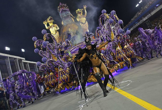 A reveller from the Rosas de Ouro Samba School takes part in a carnival at Anhembi Sambadrome in Sao Paulo February 14, 2015. (Photo by Nacho Doce/Reuters)