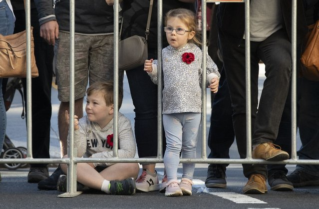 Children watch as veterans march in the Anzac Day parade in Sydney, Australia, Sunday, April 25, 2021. (Photo by Mark Baker/AP Photo)
