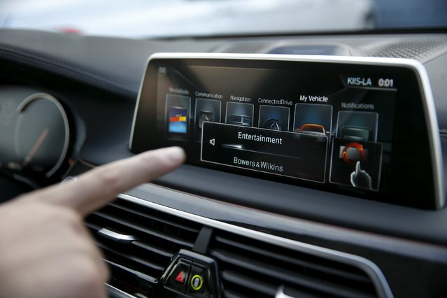 BMW's Vlatko Kalinic demonstrates a gesture control feature to control the radio volume in a 2016 BMW 750i sedan during the 2016 CES trade show in Las Vegas, Nevada January 7, 2016. (Photo by Steve Marcus/Reuters)