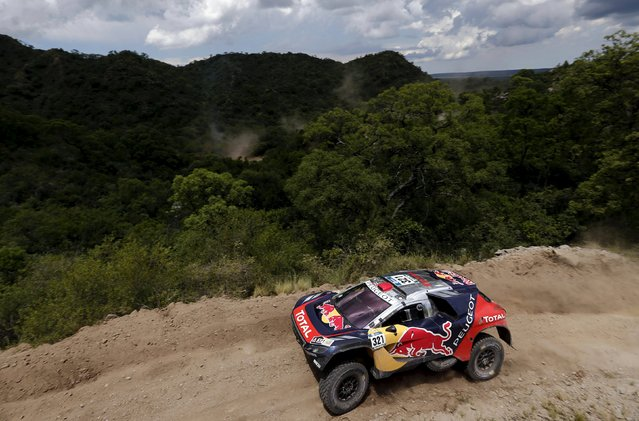 Cyril Despres of France drives his Peugeot during the 12th stage of the Dakar Rally 2016 in Cordoba province, Argentina, January 15, 2016. (Photo by Marcos Brindicci/Reuters)