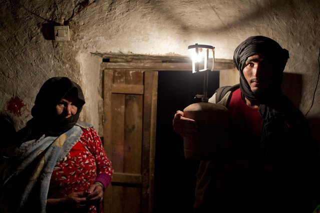 Villager Ali and his mother pose for a photograph in his front room in Ait Sghir village in the High Atlas region of Morocco February 13, 2015. (Photo by Youssef Boudlal/Reuters)