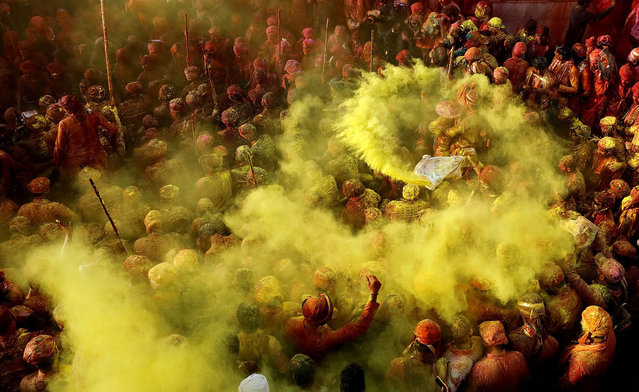 Colours of Joy, India, by Noor Ahmed Gelal. Devotees celebrate the Holi festival at Krishna Temple in Nandgaon, Uttar Pradesh. Honourable mention, Splash of Colours category. (Photo by Noor Ahmed Gelal/SIPA Contest)