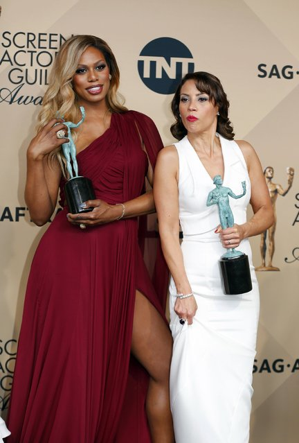 """Laverne Cox (L) and Elizabeth Rodriguez of """"Orange is the New Black"""" hold their awards for Outstanding Performance by an Ensemble in a Comedy Series during the 22nd Screen Actors Guild Awards in Los Angeles, California January 30, 2016. (Photo by Mike Blake/Reuters)"""