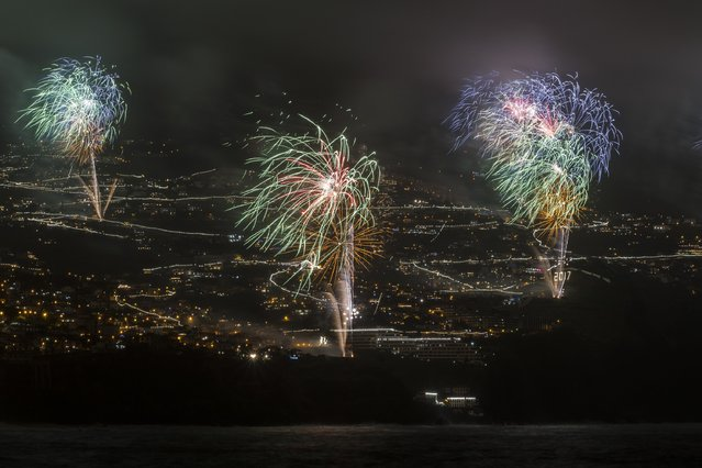 Fireworks light up the sky above Funchal Bay, Madeira Island, to celebrate the arrival of the New Year on January 1, 2017 in Funchal, Madeira, Portugal. (Photo by Octavio Passos/Getty Images)
