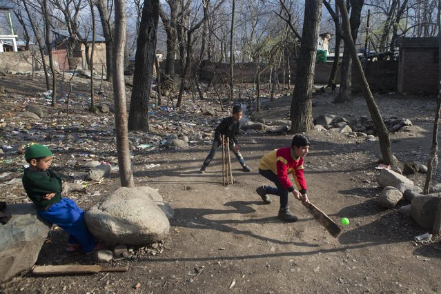 Children play cricket on the outskirts of Srinagar, Indian controlled Kashmir, Wednesday, March 25, 2015. Cricket is the most popular sport in India, played by most in open spaces throughout the country. (Photo by Dar Yasin/AP Photo)