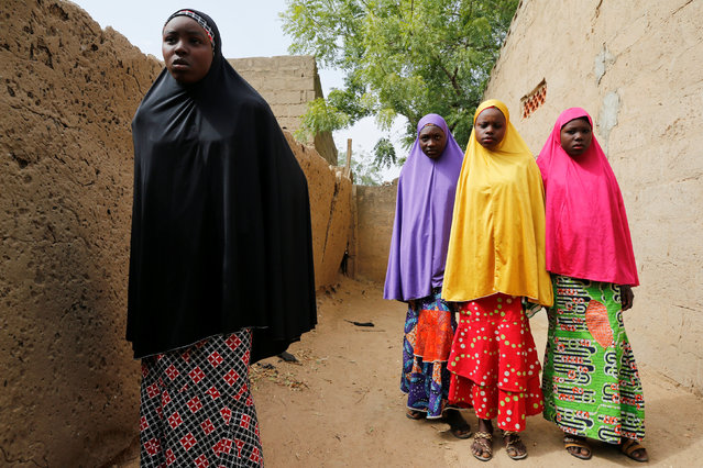 Amina Usman (L), a 15-year-old student, who was among the pupils who escaped from the attack on the school, stands with her sisters in Dapchi, the northeastern state of Yobe, Nigeria, February 23, 2018. (Photo by Afolabi Sotunde/Reuters)