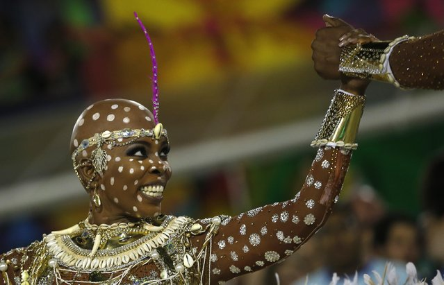Performer from the Mangueira samba school parades during carnival celebrations at the Sambadrome in Rio de Janeiro, Brazil, Tuesday, February 9, 2016. (Photo by Silvia Izquierdo/AP Photo)