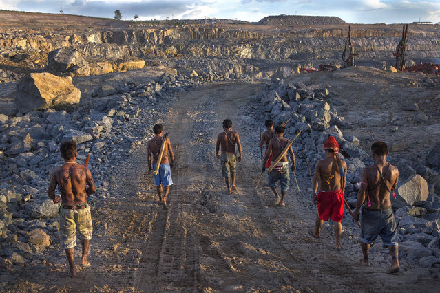 Indigenous Munduruku men survey the quarry site for the Belo Monte Dam. On May 27th, an indigenous group made up predominantly of Munduruku occupied the dam and halted construction on the main turbine site. (Taylor Weidman)
