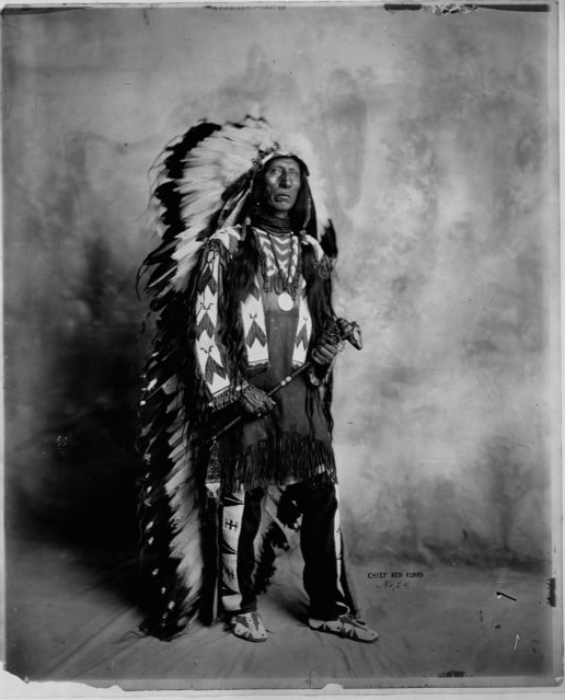 Jack Red Cloud, son of Chief Red Cloud (1822-1909), the Sioux chief who led opposition to the Bozeman Trail through Indian lands stands with a full length head dress, 1904. (Photo by Gerhardt Sisters/Library of Congress/Corbis/VCG via Getty Images)