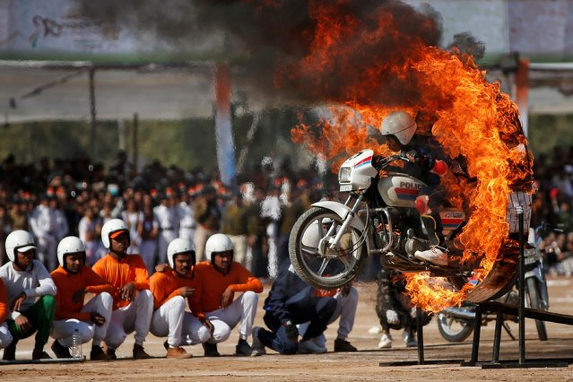A police woman performs a stunt during Republic Day celebrations in Palanpur, India, January 26, 2019. (Photo by Amit Dave/Reuters)