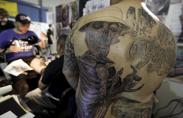 Tattoos are seen on a man's back during a tattoo convention in Ljubljana April 18, 2015. (Photo by Srdjan Zivulovic/Reuters)