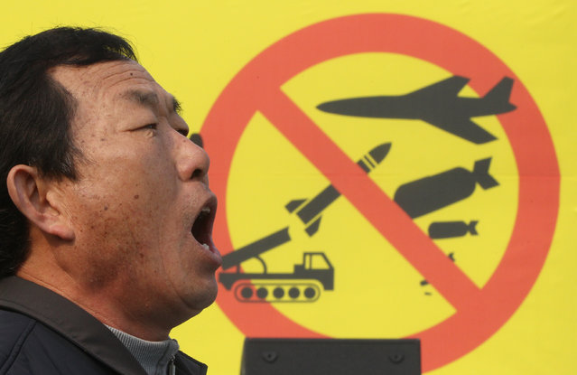 A South Korean anti-war protester yells during a rally demanding a restart of six-party talks and to stop the sanction near the government complex in Seoul, South Korea, Saturday, February 27, 2016. The United States on Thursday introduced a draft U.N. Security Council resolution that it said will significantly increase pressure on North Korea in response to its latest nuclear test and rocket launch. (Photo by Ahn Young-joon/AP Photo)