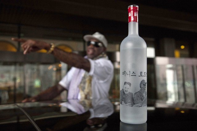 A bottle of vodka with handmade illustrations of Rodman with North Korean leader Kim Jong Un and Rodman's name in Korean sits on the roof of a car outside a Pyongyang hotel on Tuesday, January 7, 2014. Rodman came to the North Korean capital with a team of USA basketball stars for an exhibition game on Jan. 8, the birthday of North Korean leader Kim Jong Un. (Photo by David Guttenfelder/AP Photo)