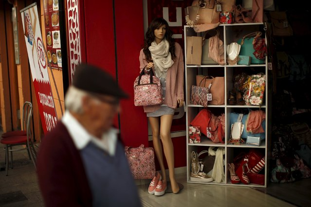 A man walks past a mannequin display at a clothes shop on La Bola street in downtown Ronda, near Malaga, southern Spain in this March 10, 2015 file photo. (Photo by Jon Nazca/Reuters)