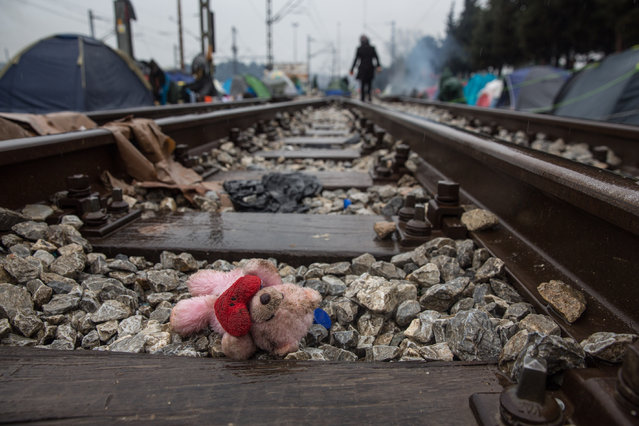 A child's doll lays on the tracks as more than 13,000 refugees are stranded at the Greek-Macedonian border, March 10, 2016 in Idomeni, Germany. (Photo by Action Press via ZUMA Press)