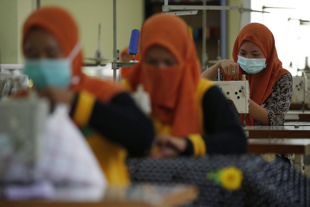 Students work on sewing machines at a government funded training center that provides vocational training to former s*x workers in Jakarta, Indonesia February 25, 2016. (Photo by Darren Whiteside/Reuters)