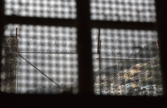 This April 14, 2015 photo shows the view a prisoner had from the window inside his cell, at the now empty Garcia Moreno Prison during a guided tour for the public in Quito, Ecuador. While its high walls separated the prisoners from society outside, they made and respected their own laws, and their own authorities, on the inside. (Photo by Dolores Ochoa/AP Photo)