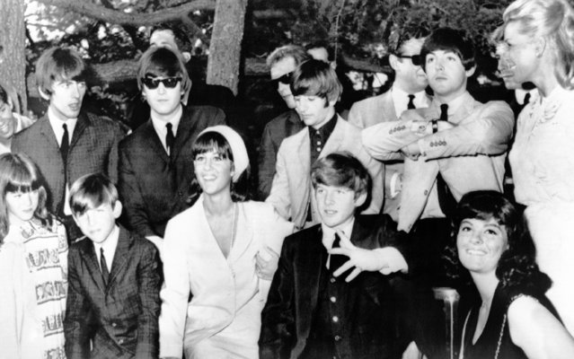 The Beatles took time off from a singing tour to pose for pictures for charity in Hollywood, on August 25, 1964. At a garden party to raise funds for the Hemophilia Foundation, the Beatles posed with children of famous motion picture stars, who gave $25 a child for the privilege. Mrs. Martin, right, and five of her children, from left, Gina, Ricci, Dino and Gail. Beatles from left are George Harrison, John Lennon, Ringo Starr and Paul McCartney. (Photo by AP Photo)