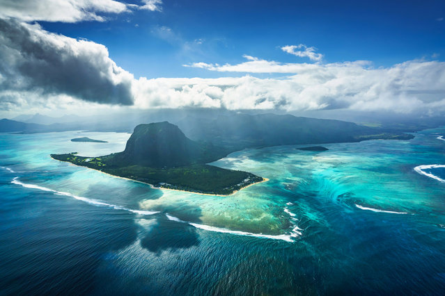 """""""The Underwater Waterfall"""" off the southwestern coast of the Indian Ocean island of Mauritius is pictured by Daniel Burton. (Photo by Daniel Burton/Travel Photographer of the Year)"""