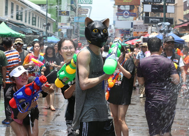 Foreign tourists join the Songkran Festival, the celebrations on Thai traditional New Year, also known as the water festival on the popular tourist strip of Khao San road, in Bangkok, Thailand, 13 April 2019. Songkran Festival is held to mark the Thai traditional New Year falling annually on 13 April, and it is celebrated thoughout the Kingdom with splashing water and putting powder on each others faces as a symbolic sign of cleansing and washing away the sins from the past year. (Photo by Narong Sangnak/EPA/EFE)